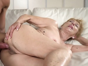 A nasty old granny gets a fast dick between her legs on chum around with annoy sofa