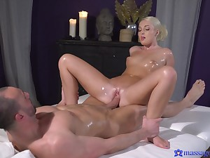 Marvelous masseuse polishing client's dick with her pussy