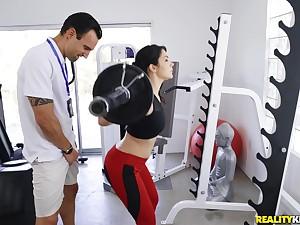 Sporty Valentina Nappi enjoys sex encircling the gym with a horny trainer