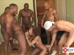Black curly bitch enjoys hardcore group sex